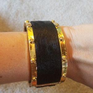 C. Wonder calf hair black and gold bangle